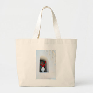 Flor roja en florero bolsa de tela grande