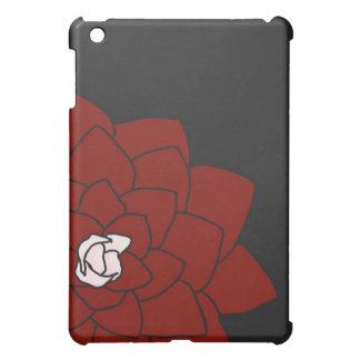Flor roja en la caja oscura del iPad del carbón de
