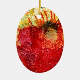 Flor roja loca adorno navideño ovalado de cerámica