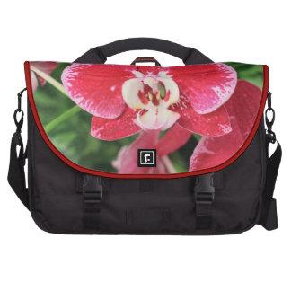 Flor rojo de la orquídea bolsas de portátil