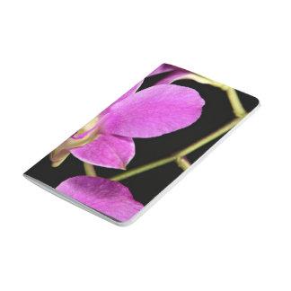 Flor rosada de la orquídea cuaderno grapado