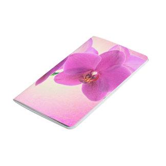 Flor rosada de la orquídea cuadernos grapados