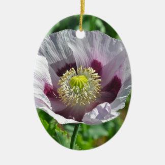 Flor rosada y púrpura de la amapola adorno navideño ovalado de cerámica