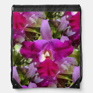 Flor tropical de la orquídea de Cattleya Mochilas
