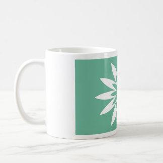 Flor verde de la estrella taza de café