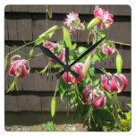 Flor verde marrón del jardín del lirio reloj de pared