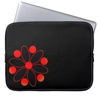 Flor y círculos rojos mangas computadora