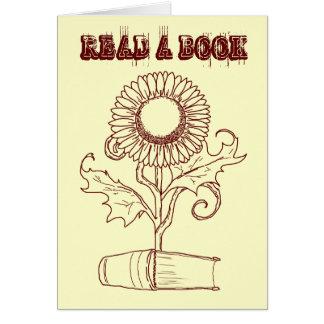 Flor y un libro tarjeta pequeña