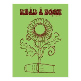 Flor y un libro postal