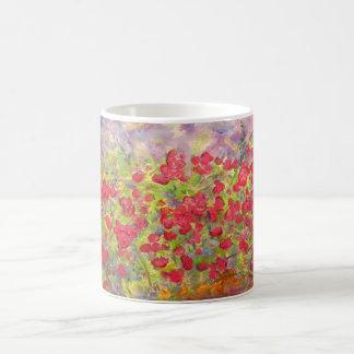 floración colorida de los rosas taza de café