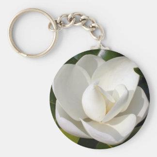 Floración de la magnolia llavero redondo tipo pin