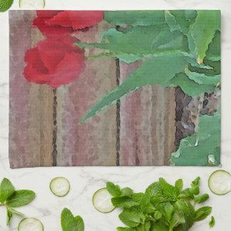 Floración roja de los pétalos de las flores de los toalla de cocina
