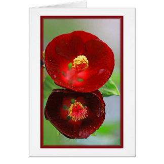 Floración roja toda la tarjeta de la ocasión