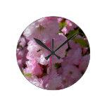 Floración rosada reloj