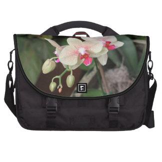 Floraciones de la orquídea bolsas de portatil