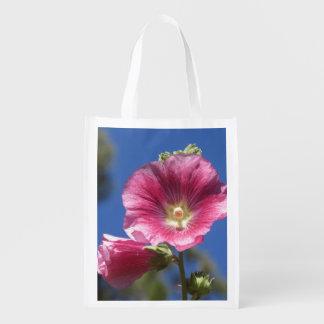 Floraciones del Hollyhock Bolsas Reutilizables