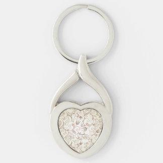Floral delicado llavero plateado en forma de corazón