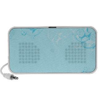 Floral design on bluish background laptop speakers
