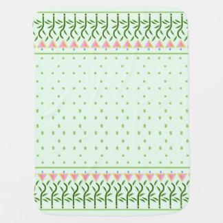 Floral panel with green spots stroller blanket