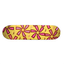 Floral pattern in pink and yellow skateboard