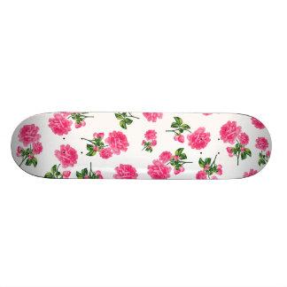 Floral patterns: pink flowers on white skateboard deck
