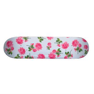 Floral patterns: pink roses on baby blue skateboard deck