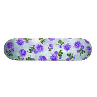 Floral patterns purple flowers on blue bokeh skateboard