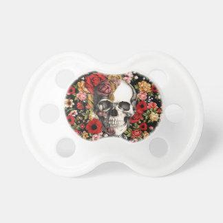Floral retro con el modelo del cráneo chupetes