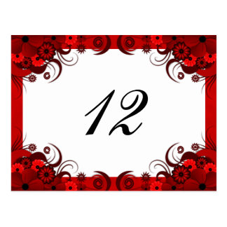 Floral rojo en las tarjetas blancas del número de postales