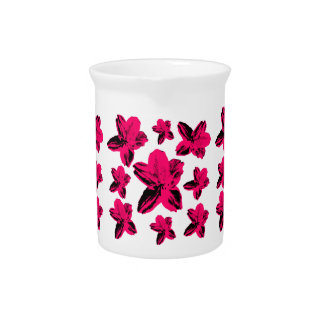 Floral texture: pink tropical flowers over white drink pitcher