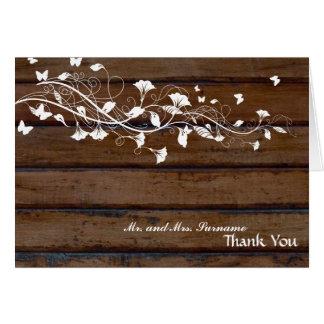 Florales blancos de madera oscuros le agradecen felicitacion