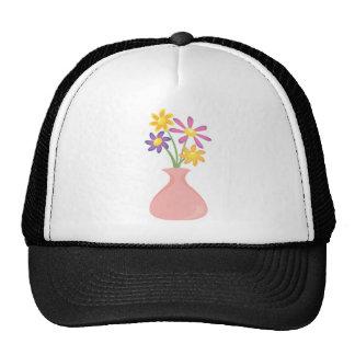 Florero bonito de flores gorros