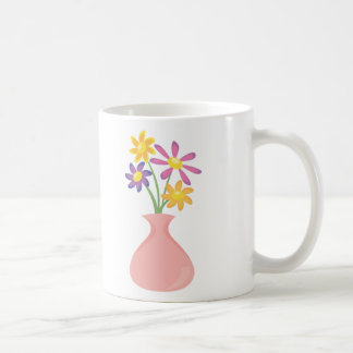Florero bonito de flores taza