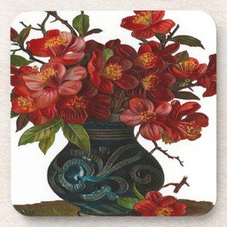 Florero de flores rojas posavasos