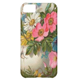 Florero de flores rosadas, blancas y azules