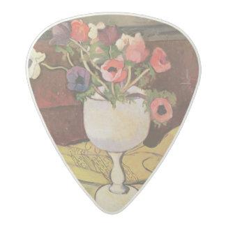 Florero de las flores, anémonas en un vidrio púa de guitarra acetal