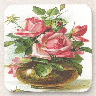 Florero de rosas rosados posavasos de bebidas