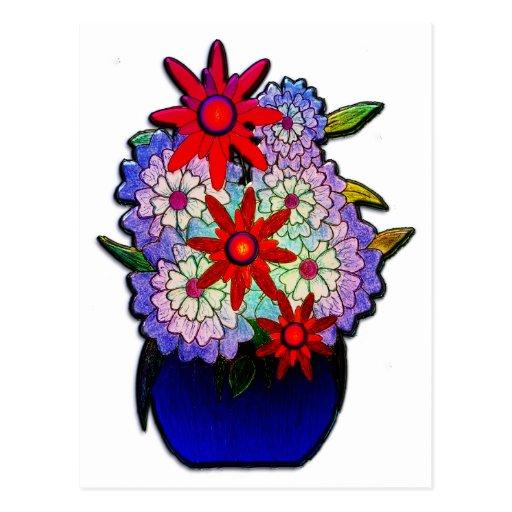 Florero del azul de cobalto con las flores postales