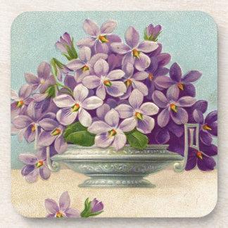 Florero del vintage de flores púrpuras posavasos de bebidas