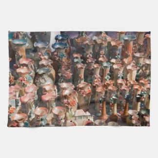 Floreros adornados múltiples toallas