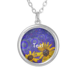 Flores abstractas amarillas azules colgante redondo