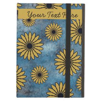 Flores amarillas en la caja azul del iPad con Kick