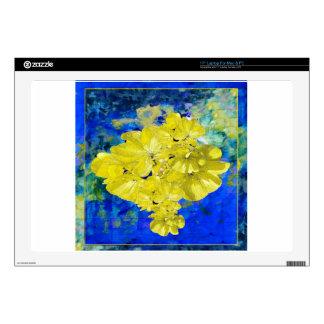 Flores amarillas en regalos azules de la laguna skins para portátil
