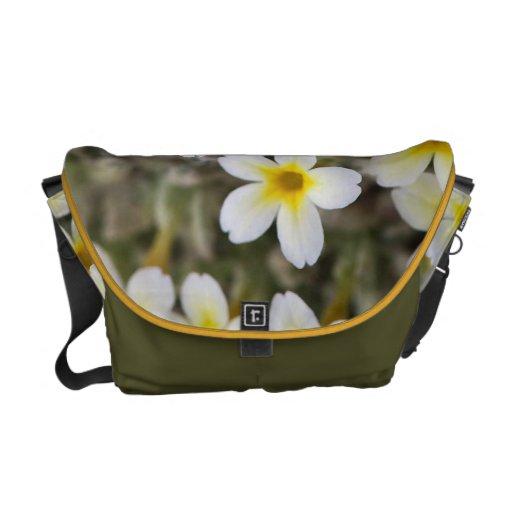 Flores amarillas minúsculas bolsas de mensajeria