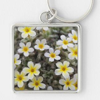 Flores amarillas minúsculas llaveros