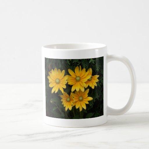 Flores amarillas tazas de café