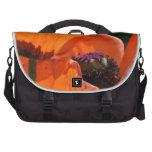 Flores anaranjadas de la amapola bolsa de ordenador