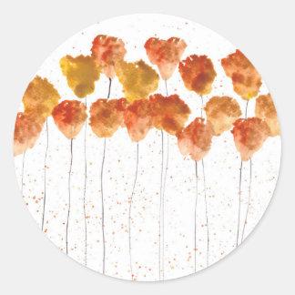 Flores anaranjadas de las amapolas pegatina redonda