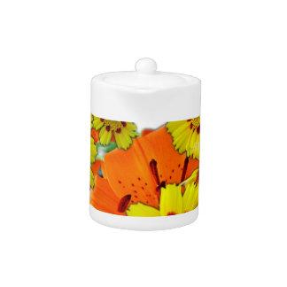 flores anaranjadas del lirio y de la margarita