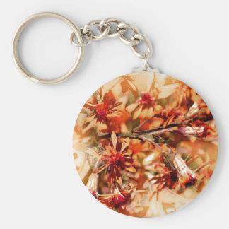 Flores anaranjadas marrones llavero redondo tipo pin
